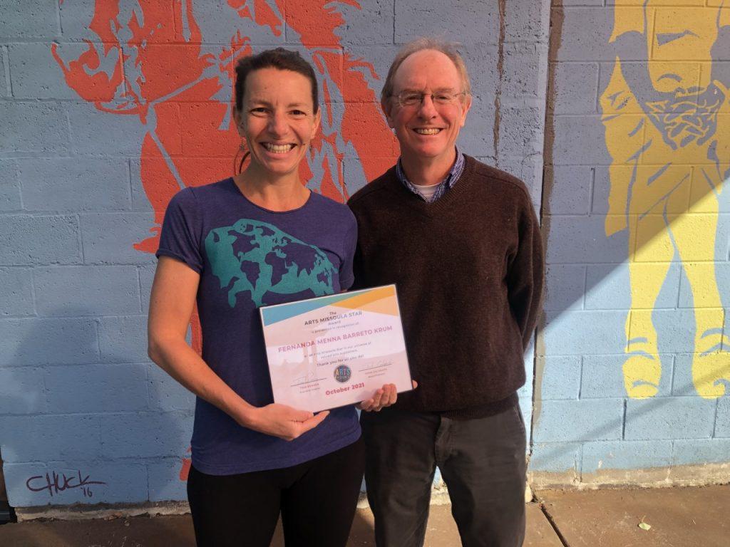 Fernanda Menna Barreto Krum, co-owner of Imagine Nation Brewing Company in Missoula, Montana, accepts the Arts Star award from Arts Missoula from Tom Bensen, executive director